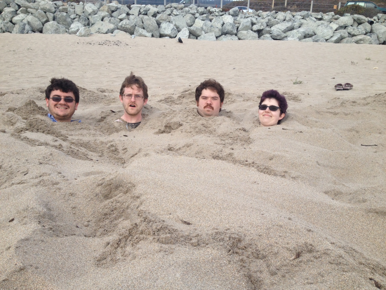 Item 66 - Four Heads at the Beach